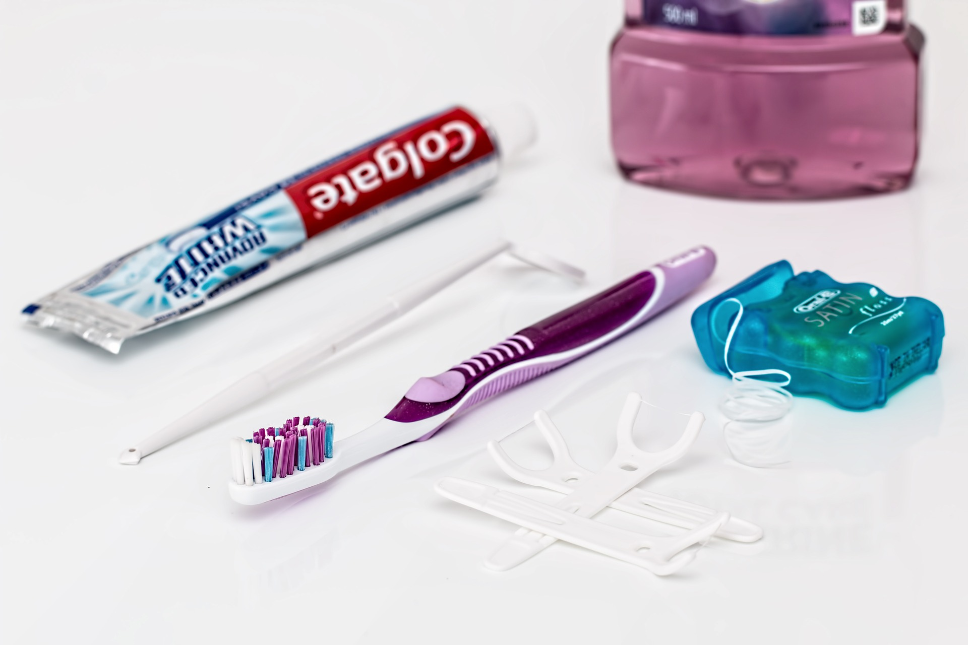 toothbrush, toothpaste, floss, and mouthwash
