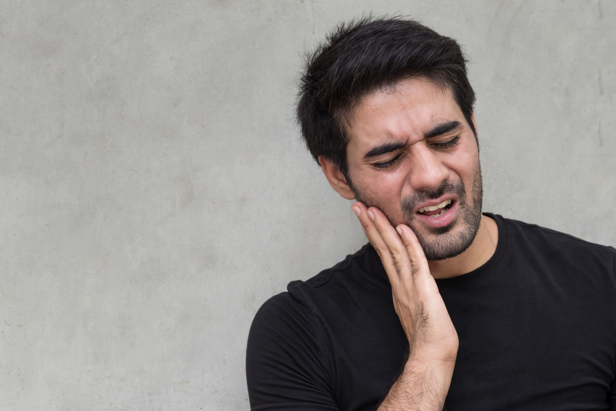 asian man with toothache pain